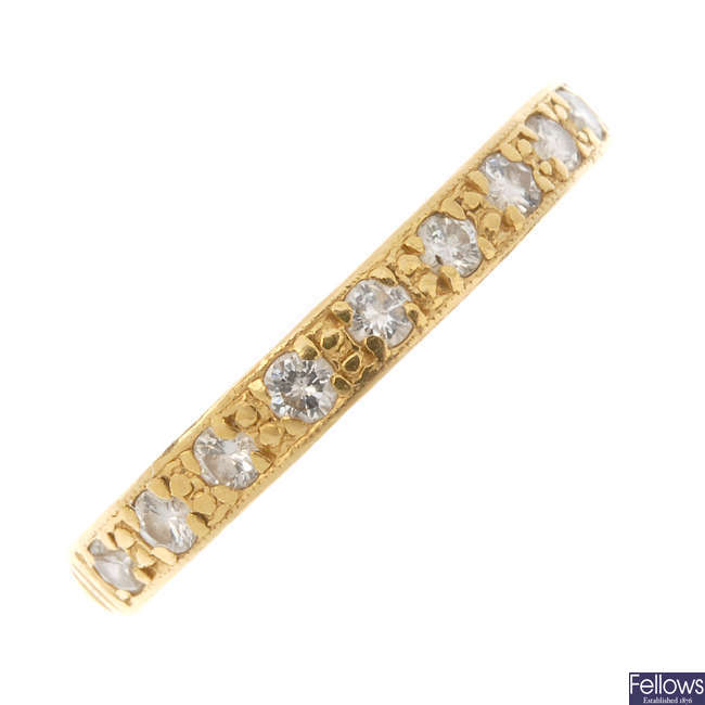 A 1950s 22ct gold diamond half-circle eternity ring.