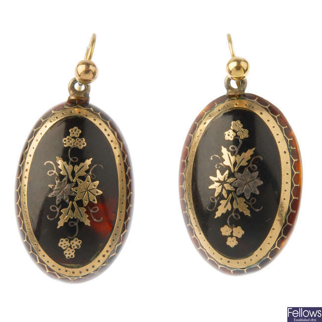A pair of late 19th century tortoiseshell pique earrings and jewellery components..