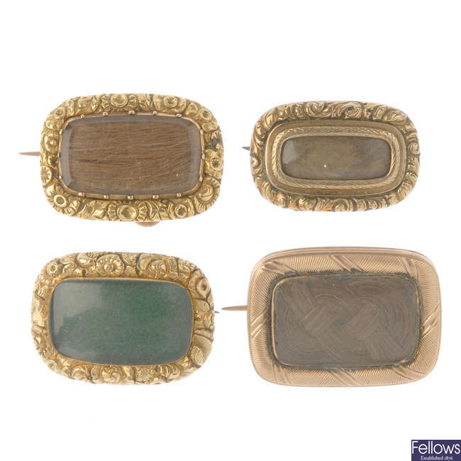 Four mid to late Victorian memorial brooches.