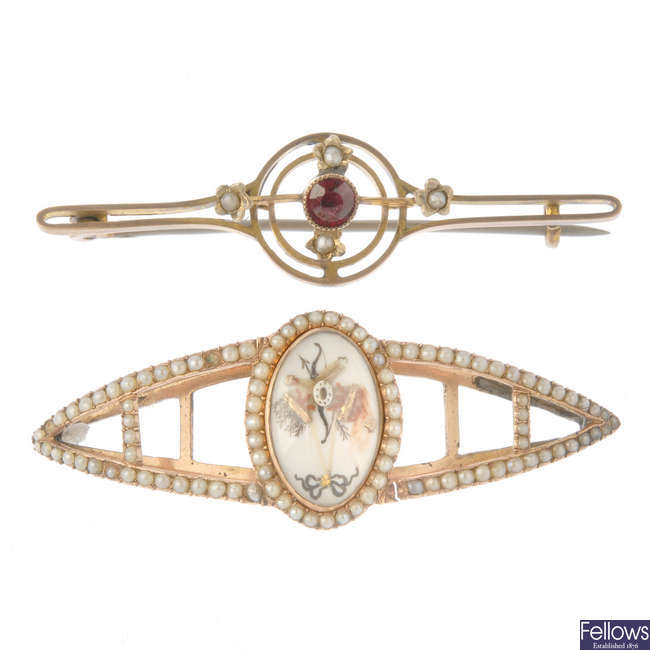 An early 20th century brooch and a mid-Victorian slide.