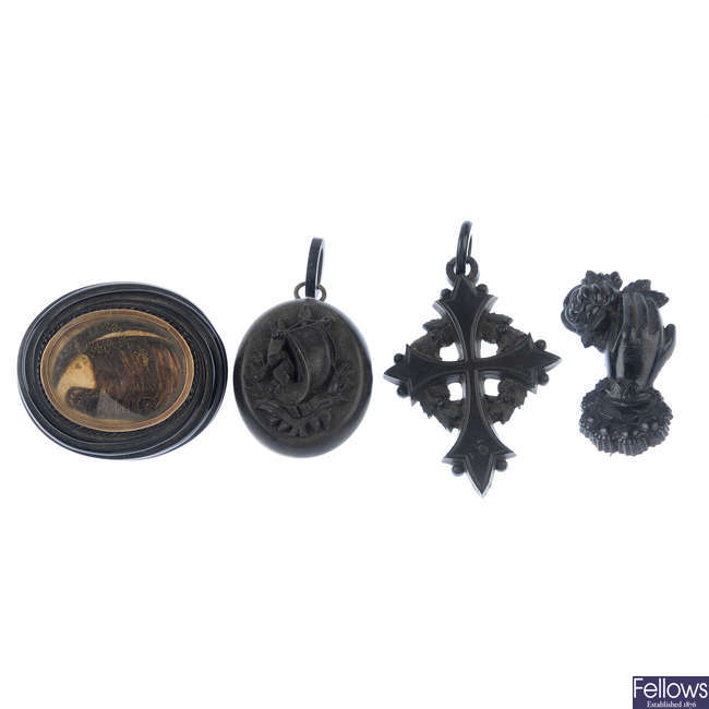 Four items of mid to late 19th century jet and vulcanite jewellery.