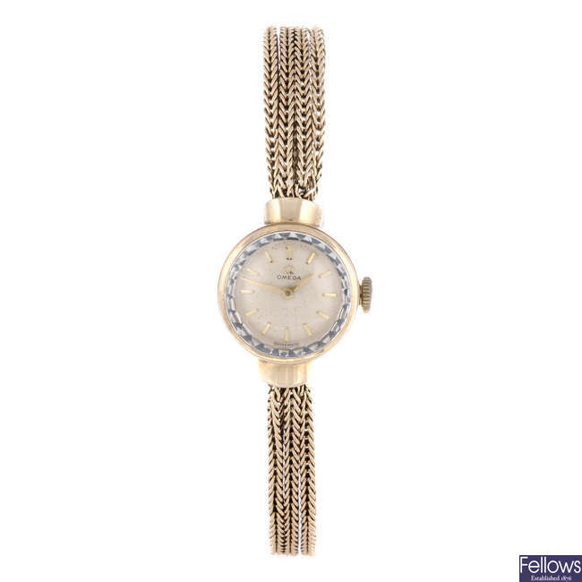 OMEGA - a lady's 9ct yellow gold bracelet watch with a pendent watch and brooch.
