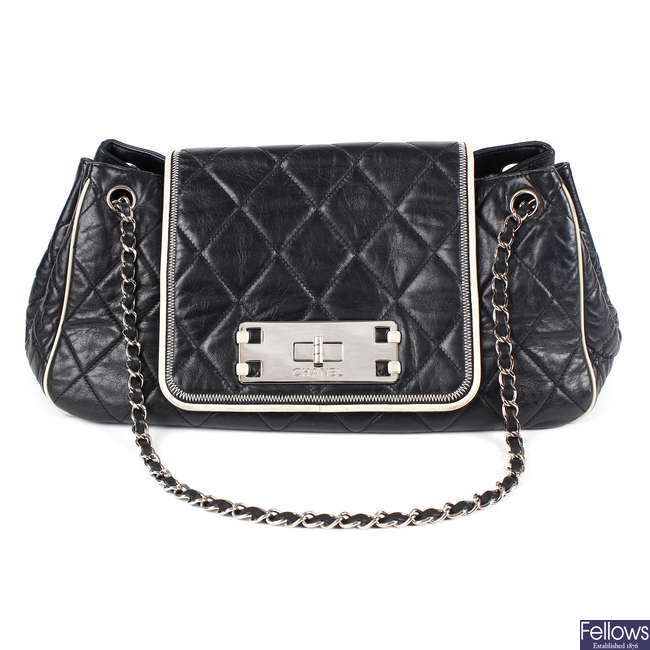 CHANEL - an East West Accordion Flap bag.