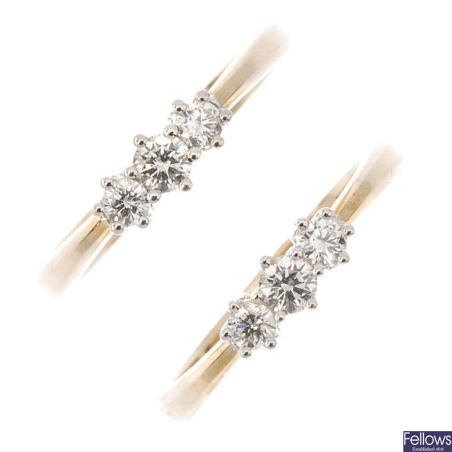 Two 9ct gold diamond three-stone rings.