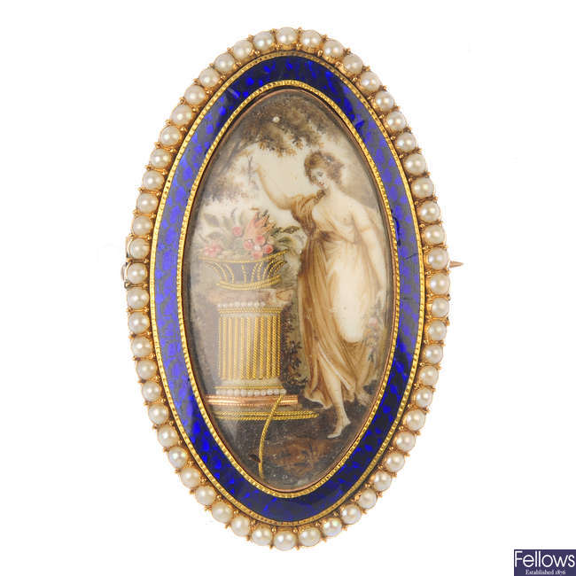 A late Georgian gold enamel and split pearl mourning brooch.