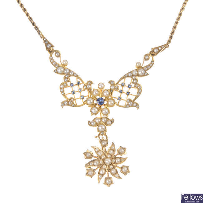 An Edwardian gold sapphire and split pearl necklace.