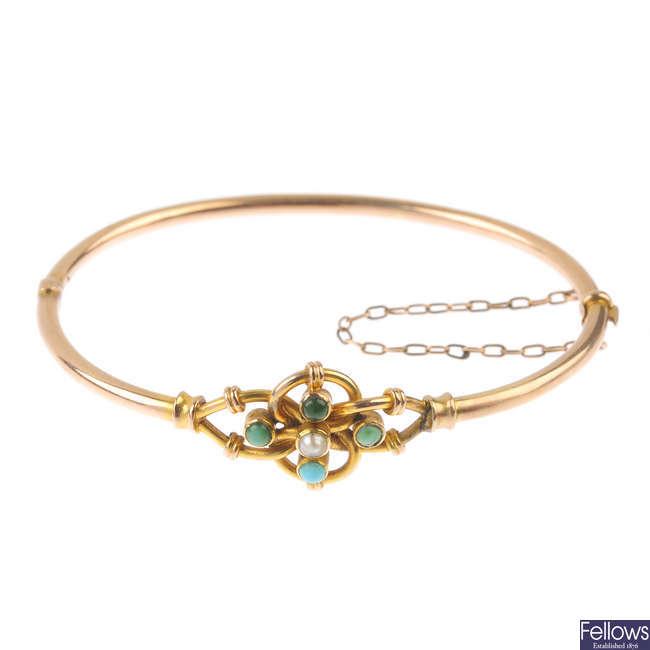 An early 20th century 9ct gold gem-set hinged bracelet.