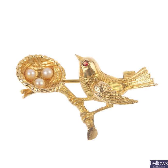 A 1960s 9ct gold gem-set bird brooch.