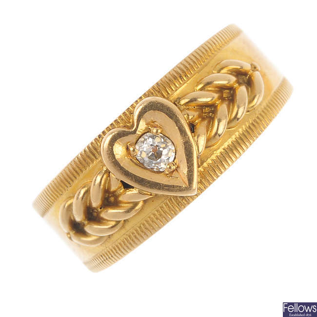 A late Victorian 18ct gold diamond heart band ring.