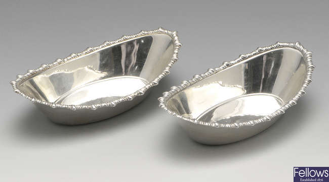 A pair of Edwardian Scottish silver bonbon dishes.