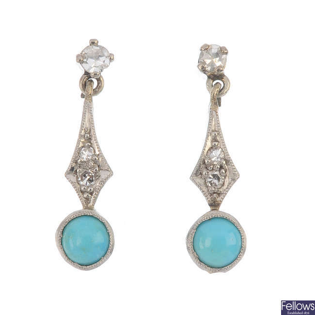A pair of turquoise and diamond ear pendants.