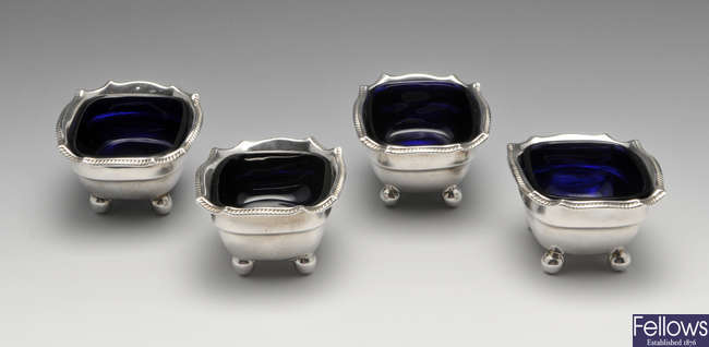 A set of four George III silver open salts.