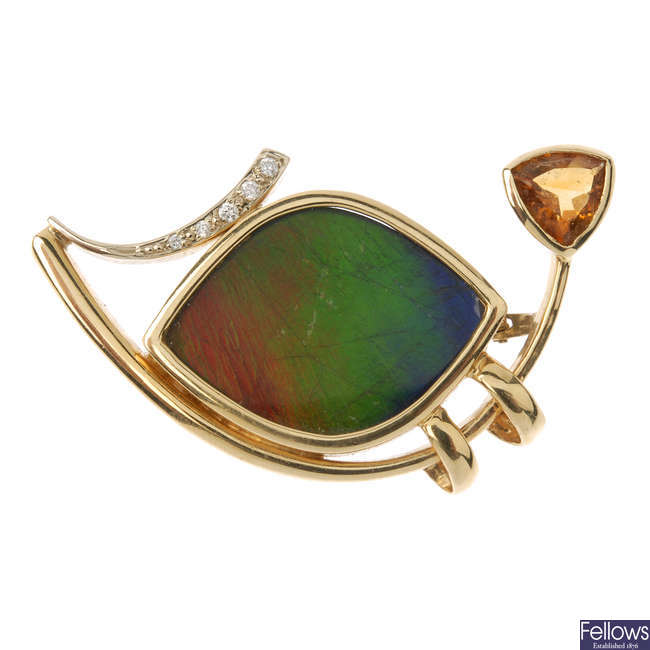 A gem-set brooch and ear pendants.