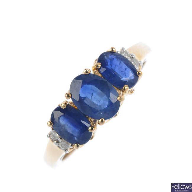 A 9ct gold sapphire three-stone and diamond ring.