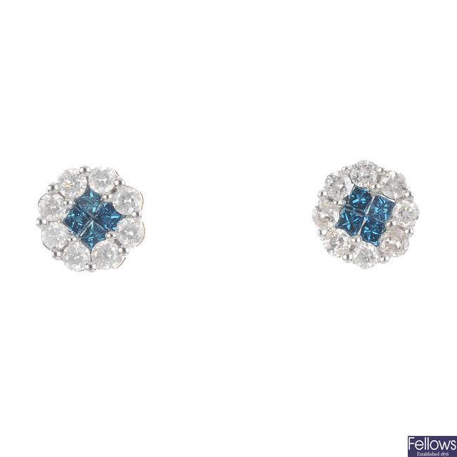 A pair of colour treated 'blue' diamond and diamond earrings.