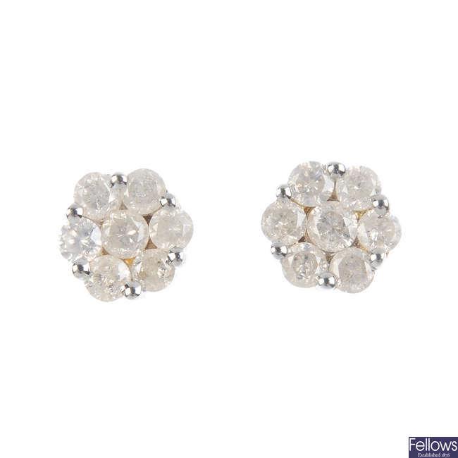 A pair of diamond cluster earrings.