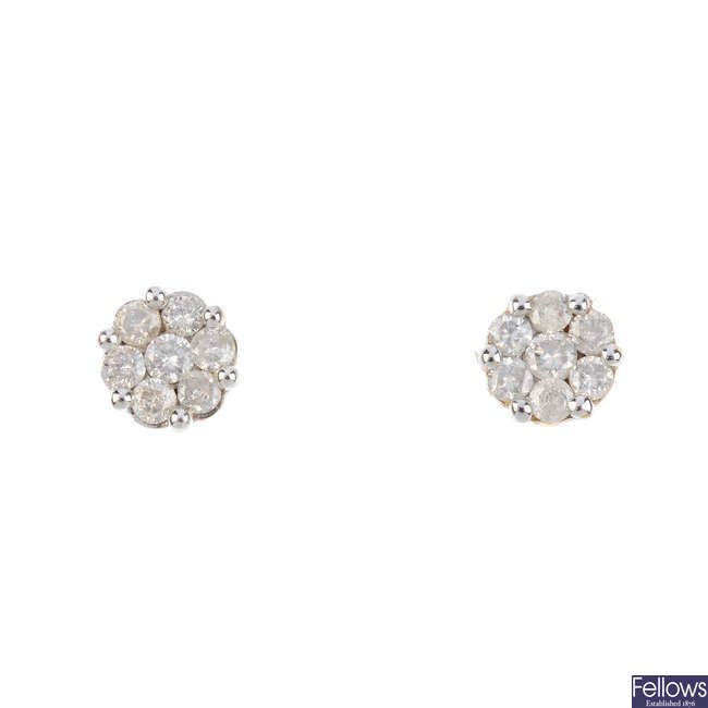 A pair of diamond floral cluster earrings.