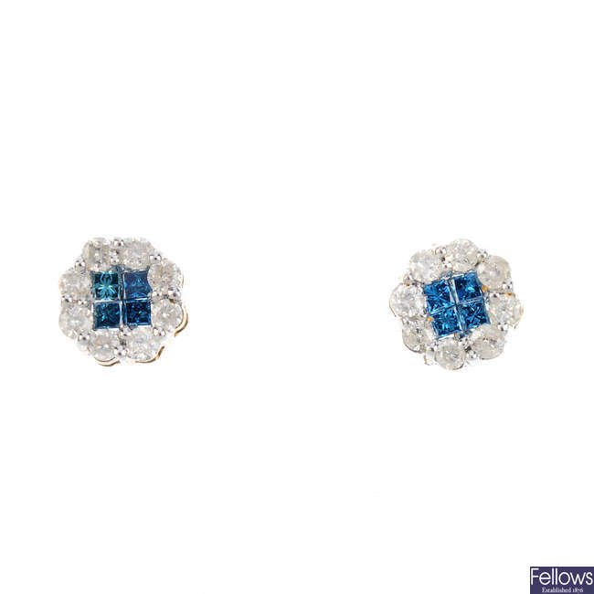 A pair of colour treated 'blue' diamond and diamond cluster earrings.