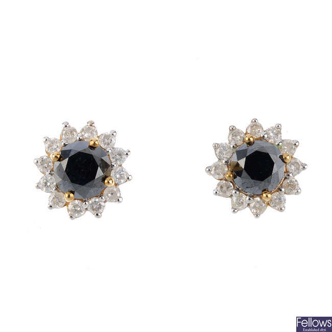A pair of diamond and gem-set floral cluster earrings.