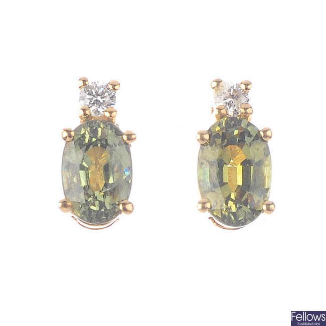 A pair of 18ct gold demantoid garnet and diamond earrings.