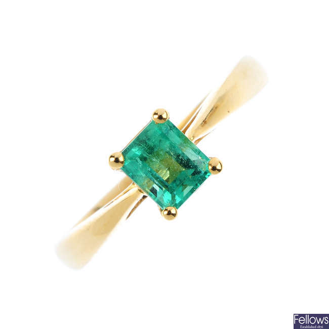 An 18ct gold emerald single-stone ring.