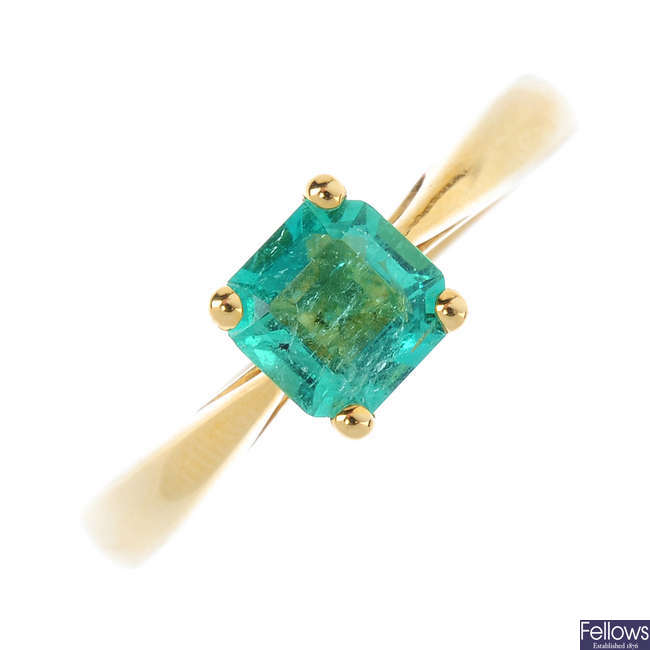 An 18ct gold Colombian emerald single-stone ring.