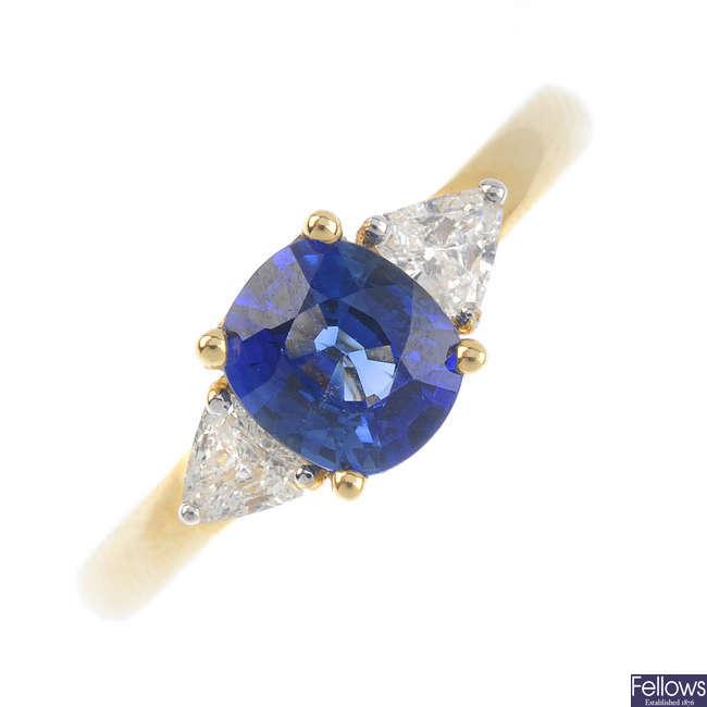 An 18ct gold Ceylon sapphire and diamond three-stone ring.
