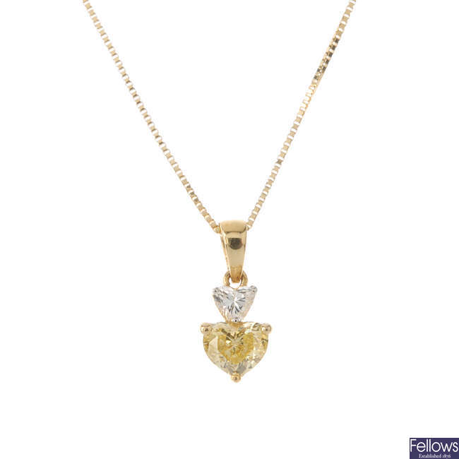 A diamond two-stone pendant, with 18ct gold chain.