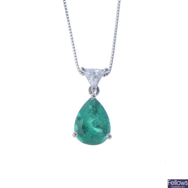 A platinum Colombian emerald and diamond pendant, with chain.