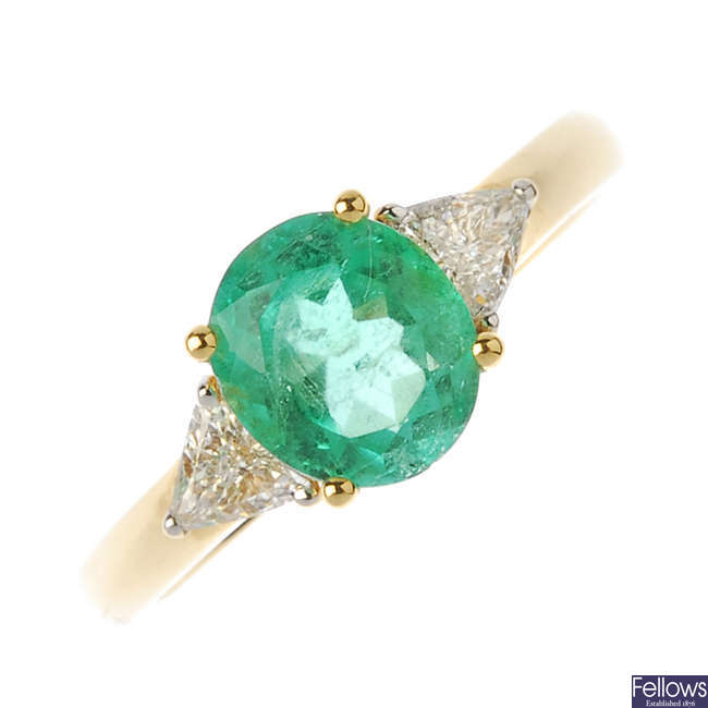 An 18ct gold Columbian emerald and diamond three-stone ring.