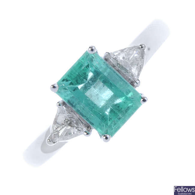 An 18ct gold Colombian emerald and diamond three-stone ring.