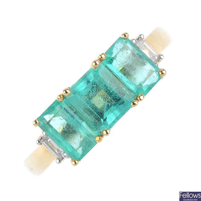 An 18ct gold Colombian emerald and diamond ring.