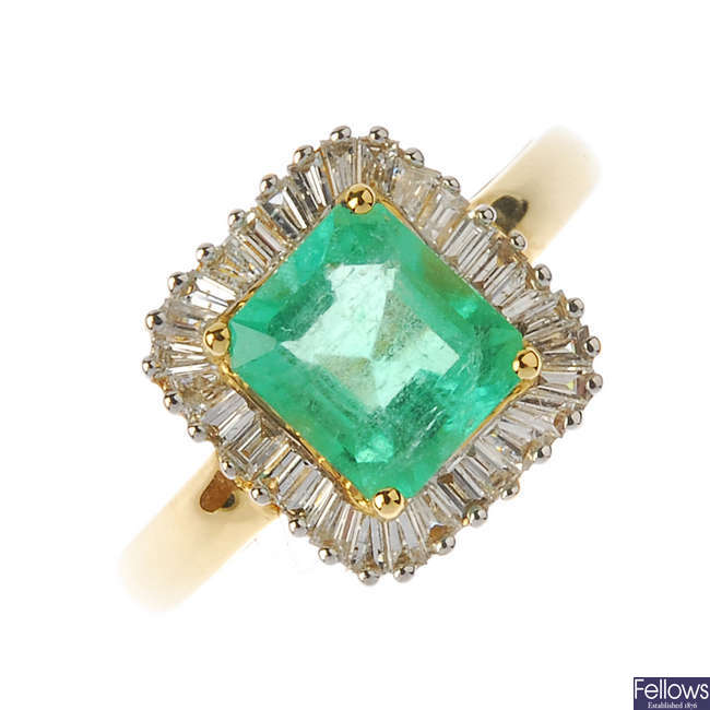 An 18ct gold Columbian emerald and diamond cluster ring.
