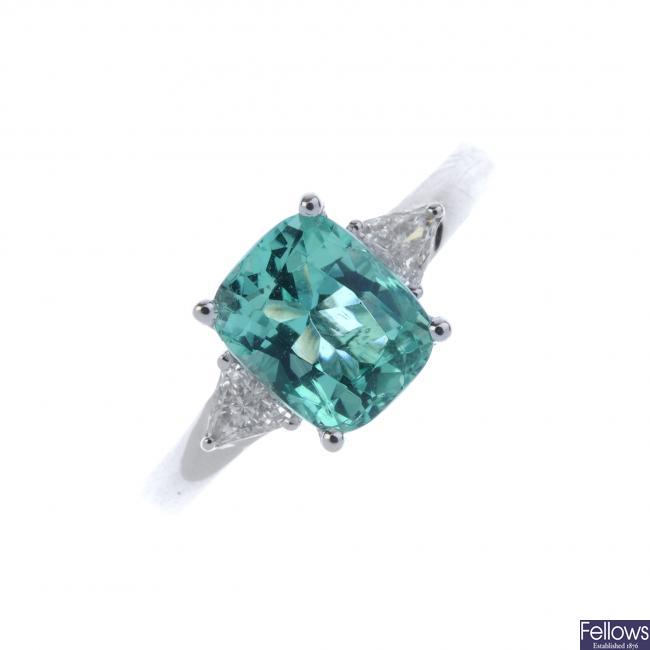 A platinum Colombian emerald and diamond three-stone ring.
