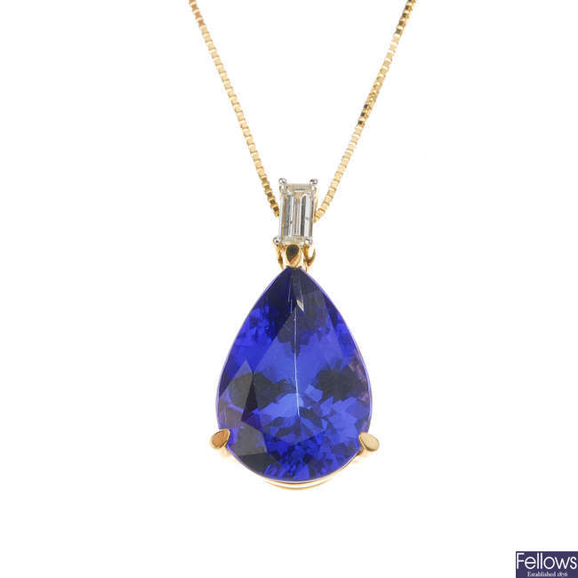 An 18ct gold tanzanite and diamond pendant, with chain.