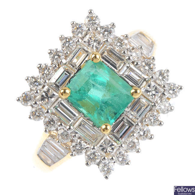 An 18ct gold Colombian emerald and diamond cluster ring.