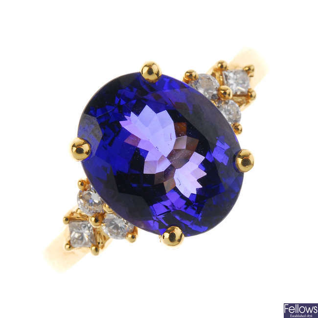 An 18ct gold tanzanite and diamond dress ring.