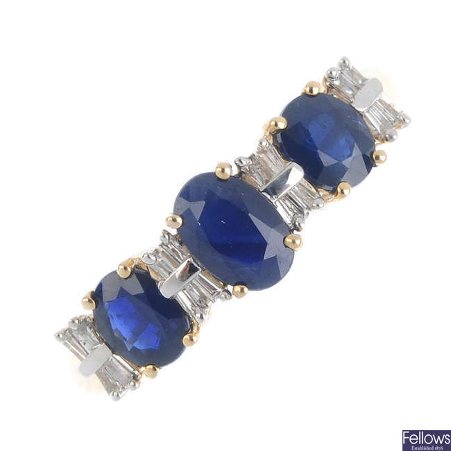 A 9ct gold sapphire and diamond three-stone ring.