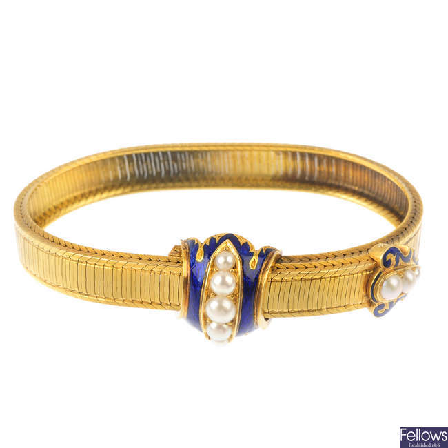 A mid 19th century enamel and split pearl bracelet.