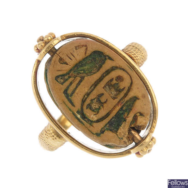 A late 19th century gold Egyptian Revival scarab ring.