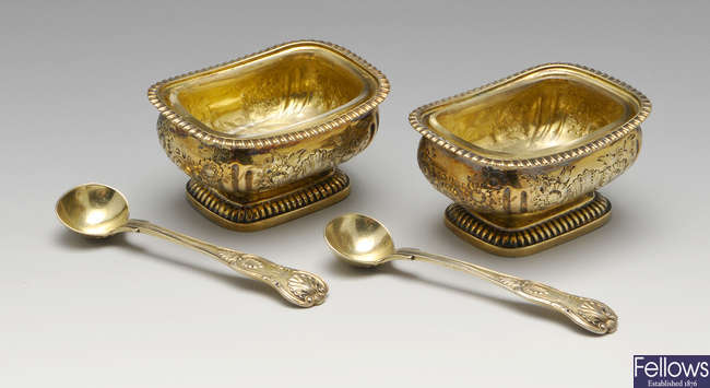 A pair of George III silver-gilt open salts, plus a pair of early Victorian silver-silt Kings pattern condiment spoons.