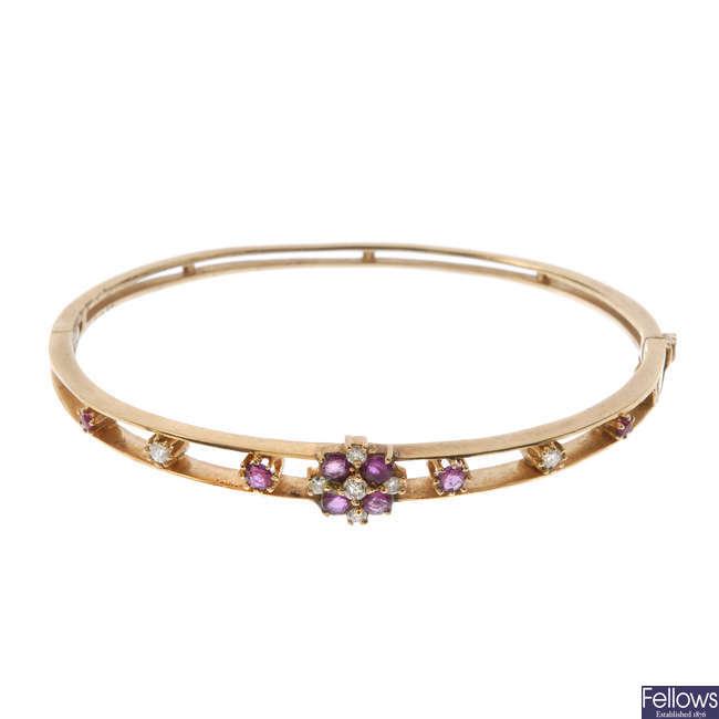 A 9ct gold ruby and diamond bangle.