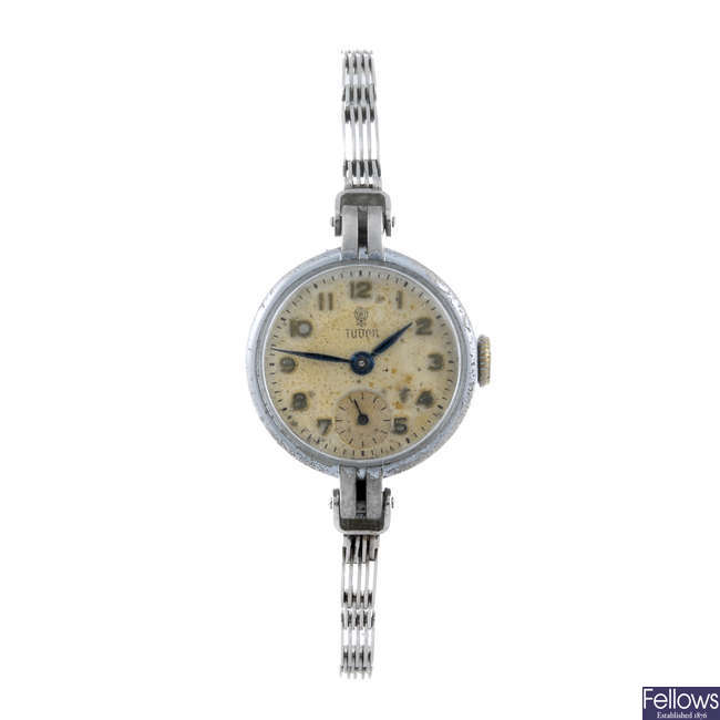 TUDOR - a lady's base metal bracelet watch with two other watches.