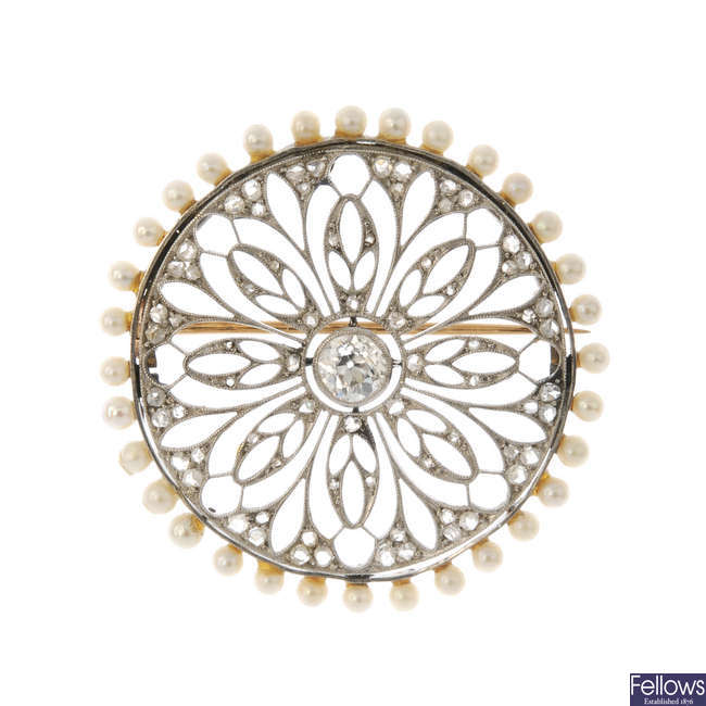 An early 20th century platinum, diamond and seed pearl brooch.