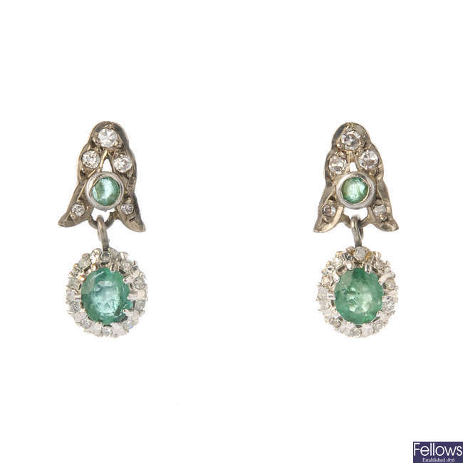 A pair of emerald and diamond ear pendants.