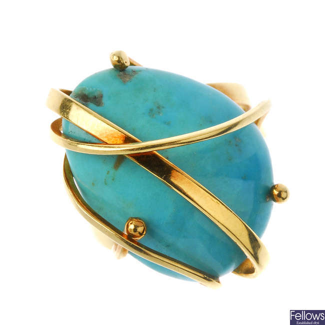 A turquoise dress ring.