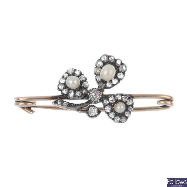 A late 19th century gold, cultured pearl and diamond shamrock bar brooch.