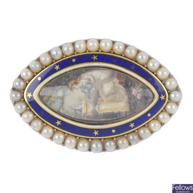 A mid 19th century gold, enamel and split pearl memorial brooch.