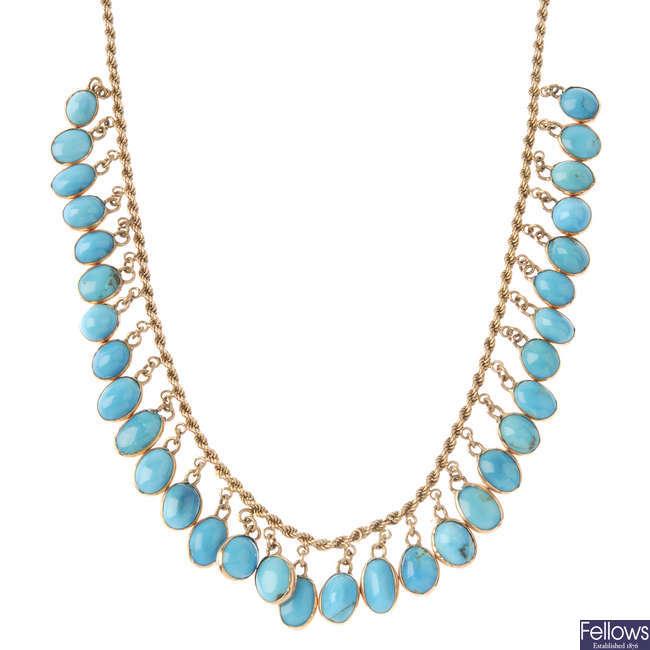 A turquoise fringe necklace.
