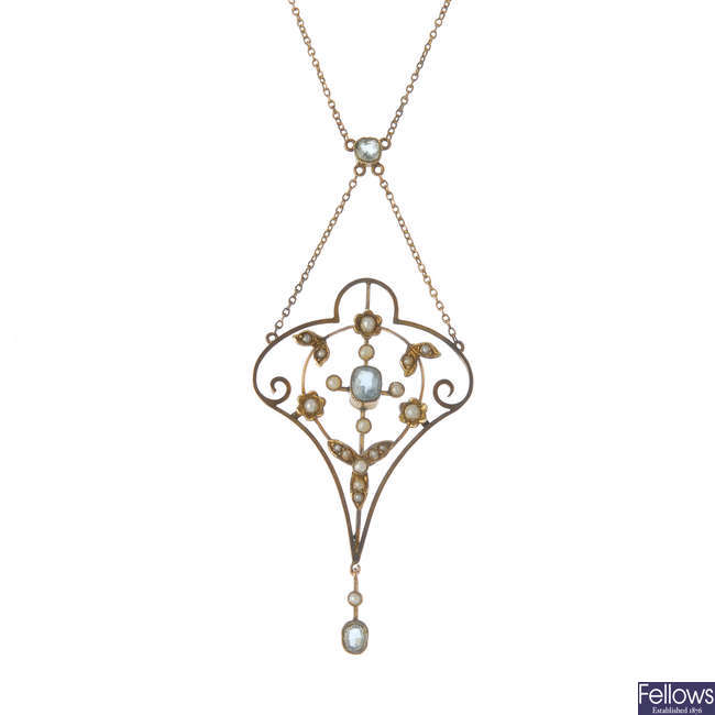 An early 20th century 9ct gold aquamarine and split pearl pendant, on chain.